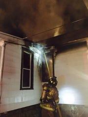 A Fond du Lac firefighter battles a blaze April 14
