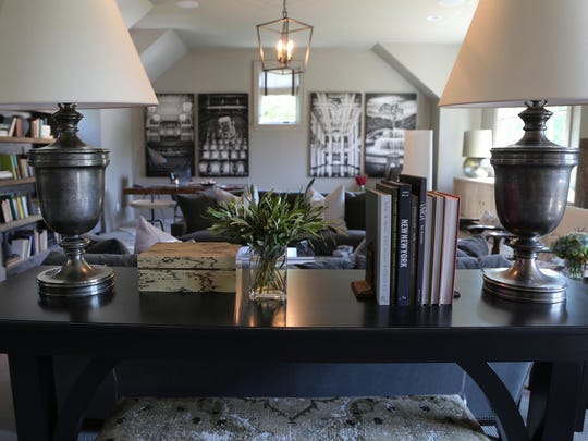 Tables and lamps of equal heights flank sofas and beds, such as this upstairs space designed by Julie Couch Interiors.