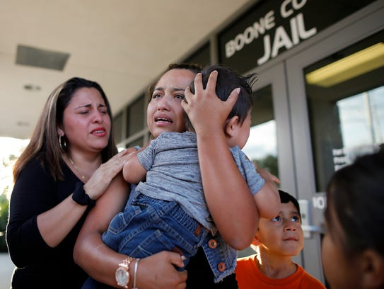 Riccy Enriquez Perdomo hugs her 11-month-old son, Rony,