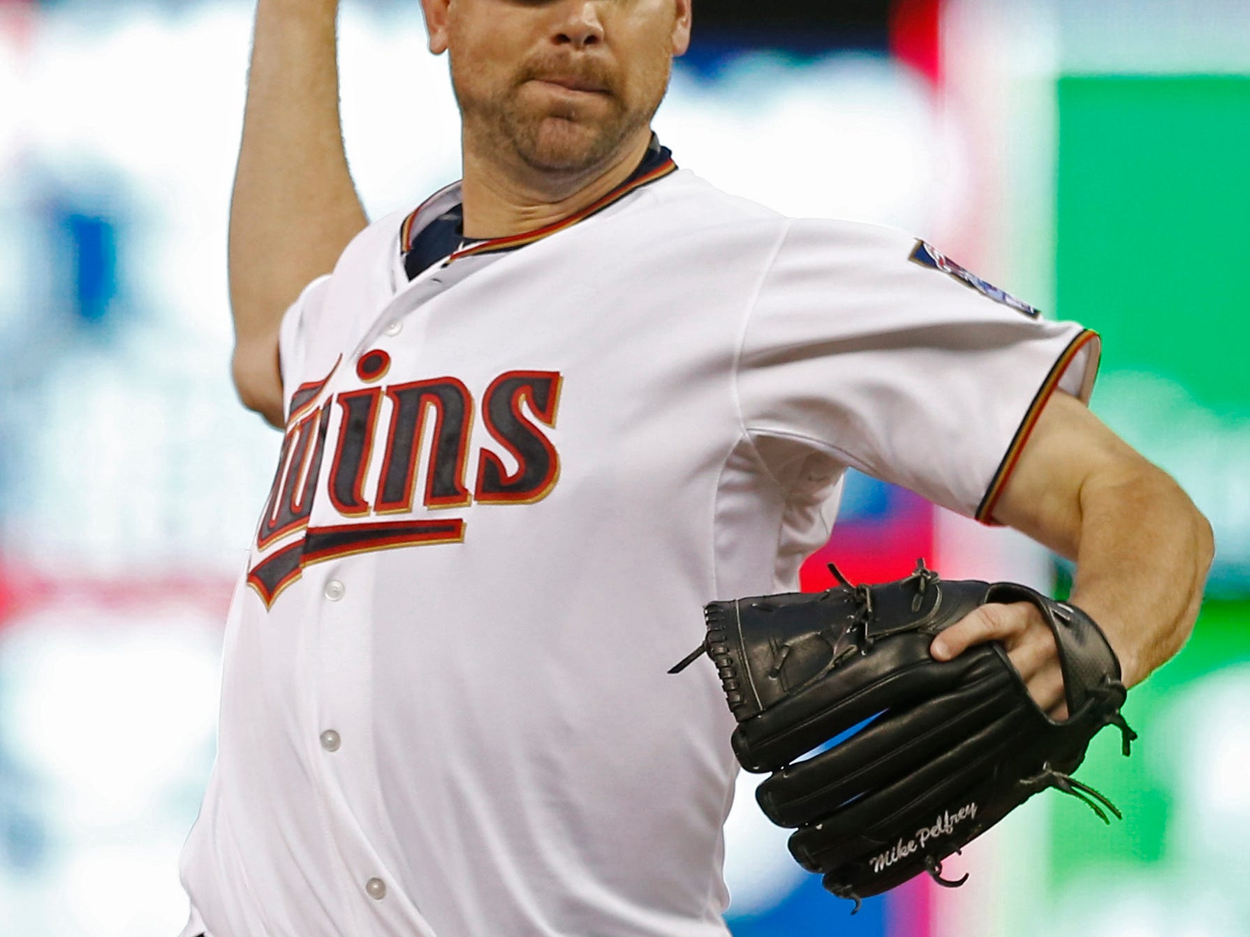 Minnesota Twins pitcher Mike Pelfrey throws against the Detroit Tigers in the fourth inning of a baseball game, Tuesday, April 28, 2015, in Minneapolis. (AP Photo/Jim Mone)