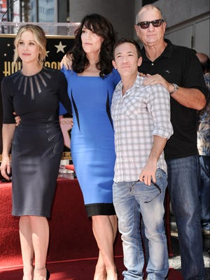 """Christina Applegate, from left, Katey Sagal, David Faustino, and Ed O'Neill from """"Married with Children"""" attend the ceremony honoring Katey Sagal with a star on The Hollywood Walk Of Fame on Tuesday, Sept. 9, 2014, in Los Angeles."""