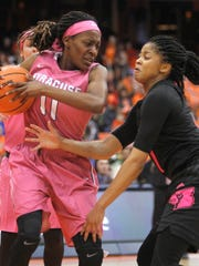 Louisville's Arica Carter, right, put pressure on Syracuse's