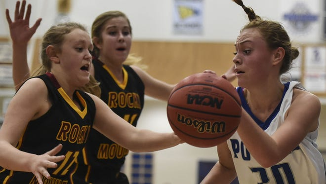 Rocky Mountain's Holly Mackie, from left, and Lena Long-Shore defend Poudre's Cecelia Berkner in a game last season.