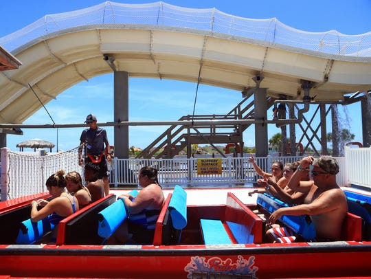 Patrons prepare to ride the Padre Plunge on Friday,
