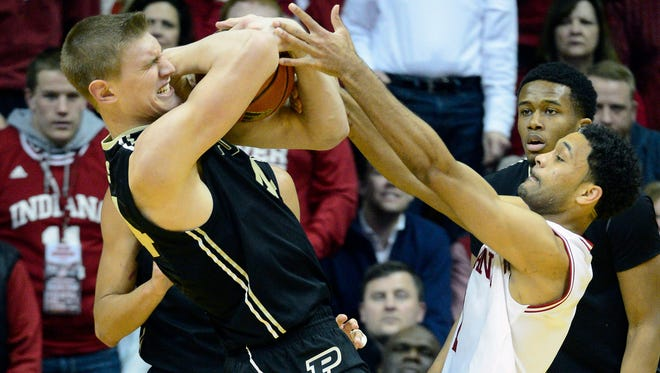 Purdue center Isaac Haas (44) attempts to keep a ball away from Indiana guard James Blackmon Jr. during the second half of the Boilermakers' 67-63 victory at Assembly Hall