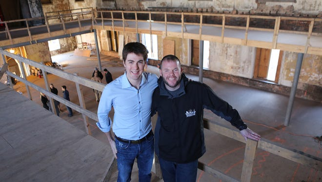 Co-owners Dave Kassling, left, and Kevin Moreland inside what will be Taft's Ale House in Over-the-Rhine.