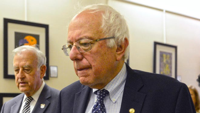 Bernie Sanders and Davenport Mayor Bill Gluba walk to the elevator after a coffee sit-down at City Hall in Davenport, Iowa, on May 29, 2015.
