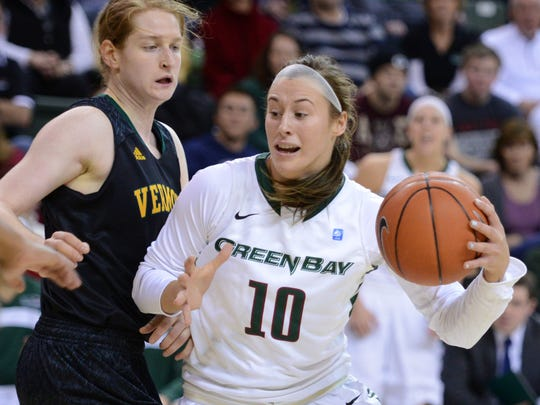 University of Wisconsin-Green Bay's Mehryn Kraker drives to the basket against Vermont's Emilie Cloutier during the second half of the game at the Kress Events Center, Saturday, December 20, 2014. H. Marc Larson/Press-Gazette Media/@HMarcLarson