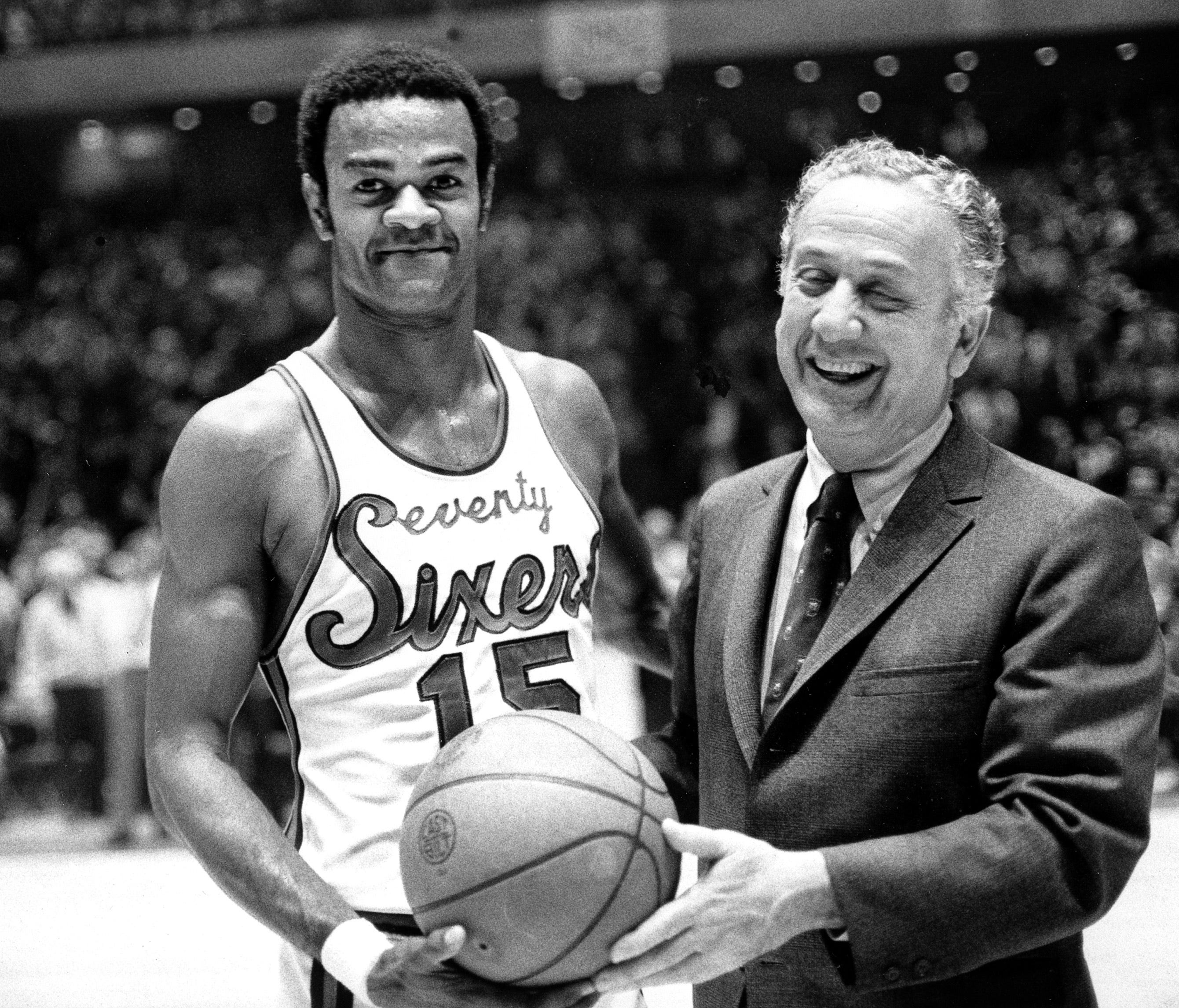 In this Jan. 29, 1971 file photo, Hal Greer (15) of the Philadelphia 76ers accepts a ball from Sixers owner Irv Kosloff.