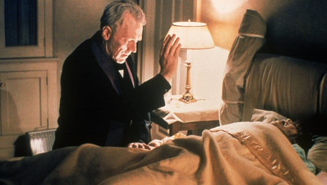 "Father Merrin (Max von Sydow) tries to help a possessed girl (Linda Blair) in ""The Exorcist."""