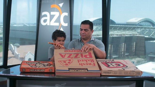 Jesse Sanchez and his son Mateo Sanchez try out some pizza during the azcentral.com pizza taste test.