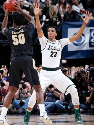Deyonta Davis, right, of the Michigan State Spartans defends against Caleb Swanigan of the Purdue Boilermakers on March 13, 2016, in Indianapolis.
