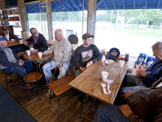 A crew of coffee consumers congregate daily at the