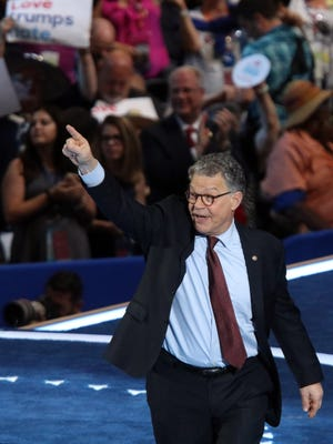 Sen. Al Franken, D-Minn., finishes speaking during the Democratic National Convention at Wells Fargo Arena July 25, 2016.