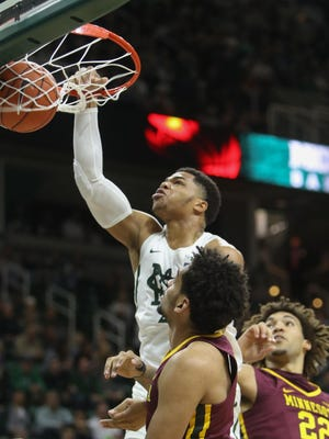 Michigan State guard Miles Bridges scores against Minnesota defenders Jordan Murphy and Reggie Lynch during the first half of MSU's 65-47 win Wednesday at Breslin Center.
