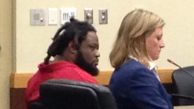 Thomas Dan Edison sits beside his lawyer during his bond reduction hearing.