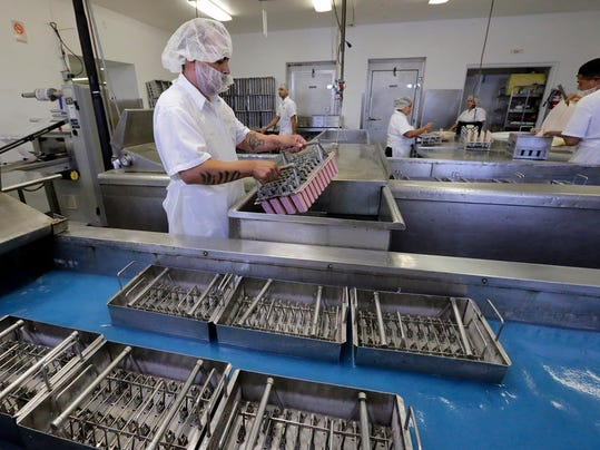 """Fruitiki employees continue the process of making the locally produced fruit bars at the companies factory located in central El Paso. The fruit bars that the company manufactures will begin being sold in over 400 Wal-Mart stores. """""""