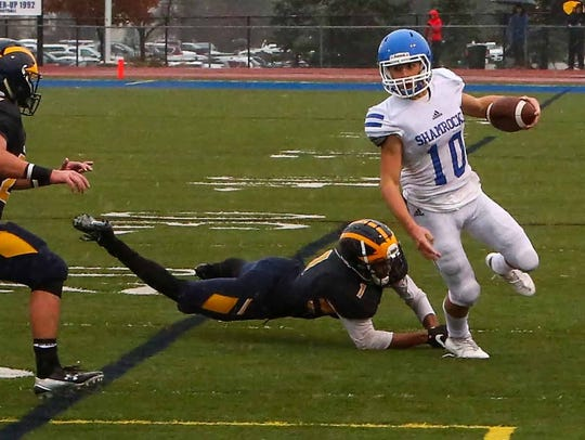 Catholic Central's Marco Genrich gets by around Clarkston's