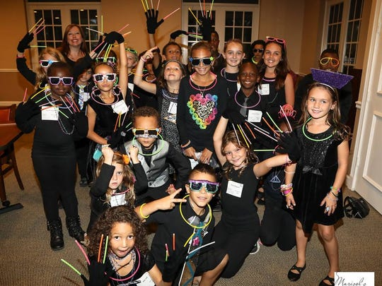 Boys & Girls Clubs of St. Lucie County Infinity and Ken Pruitt unit members at the Steak & Stake Dinner and Auction on Oct. 21.