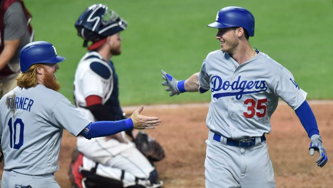 Los Angeles Dodgers first baseman Cody Bellinger (35) celebrates his three-run home run with third baseman Justin Turner (10) in the ninth inning against the Cleveland Indians at Progressive Field.