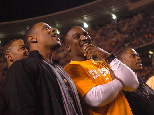 Peerless Price and Tee Martin, members of Tennessee's 1998 national championship team, gather on the field to be recognized before the game against Alabama in Neyland Stadium on Oct. 25, 2008.