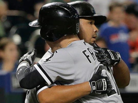 Todd Frazier hugs  Chicago White Sox teammate Jose Abreu after launching a two-run home run at Citi Field.