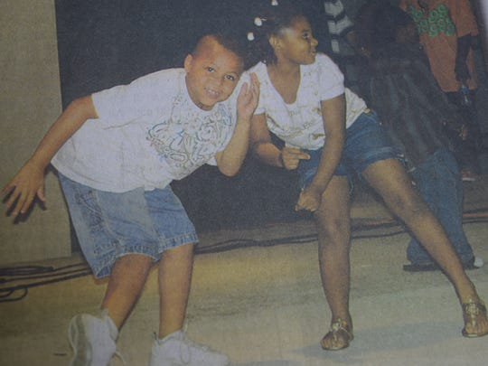 Kieshon Martin and Antazia Keyes danced for downtown Morganfield's Unity Fest in July 2009.