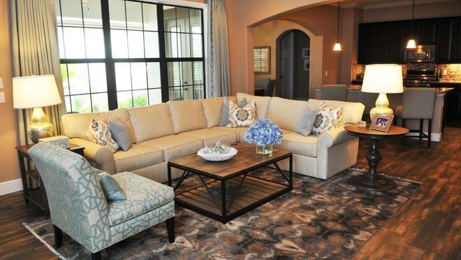 The living room in a home in Arrivas Village in Viera West decorated by Carol Chatel, design consultant with Ethan Allen furniture store at The Avenue Viera.