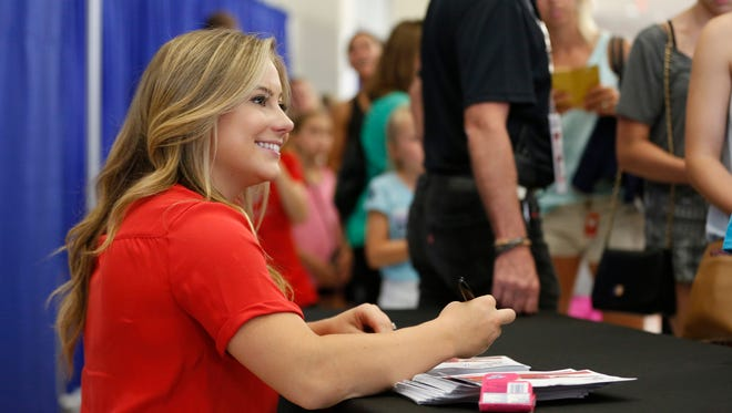 Olympic gold medalist Shawn Johnson signs autographs for fans Sunday, June 26, 2016, at the P&G Gymnastics Championships at Chaifetz Arena in St. Louis. The West Des Moines native trained at Chow's Gymnastics during her run to 2008 Olympics.