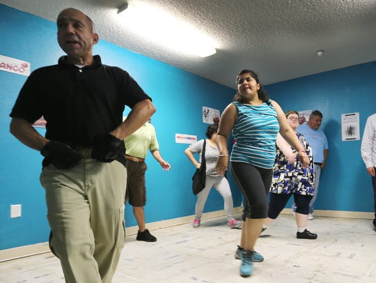 Albert Medina, left, leads a dance class at Emergence