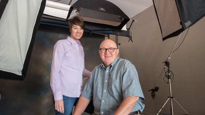Hollis and Bob Conway at their Conway Photography studio in Battle Creek.