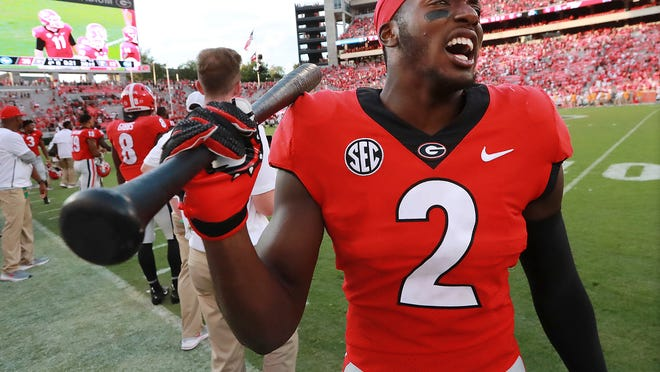 Georgia defensive back Richard LeCounte III holds the hit stick while celebrating a 38-12 victory over Tennessee in the final seconds of an NCAA college football game Saturday, Sept 29, 2018, in Athens. (Curtis Compton/Atlanta Journal-Constitution via AP)