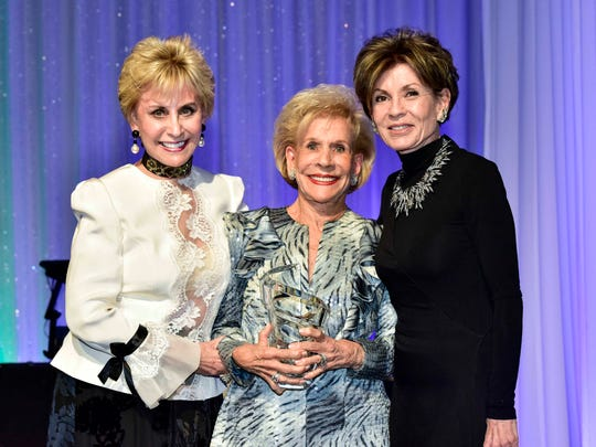 Presenters Barbara Keller (left) and Terri Ketover flank Lifetime Passion Award honoree Annette Bloch (center).