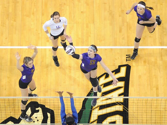 The Lexington volleyball team plays during the Division