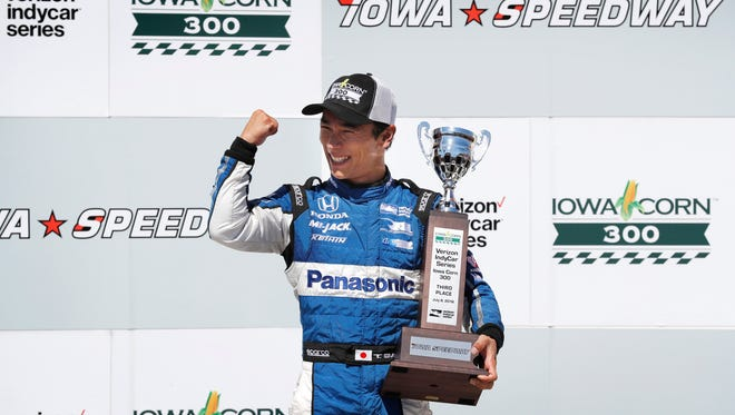 Takuma Sato celebrates after finishing in third place in an IndyCar Series auto race Sunday, July 8, 2018, at Iowa Speedway in Newton, Iowa.