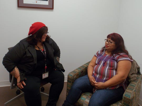 Fanny Ortiz (right), who left an abusive marriage after nearly a decade, meets weekly with therapist Brittany Martinez at the East Los Angeles Women's Center. The office is located on the campus of the Los Angeles County-USC Medical Center.