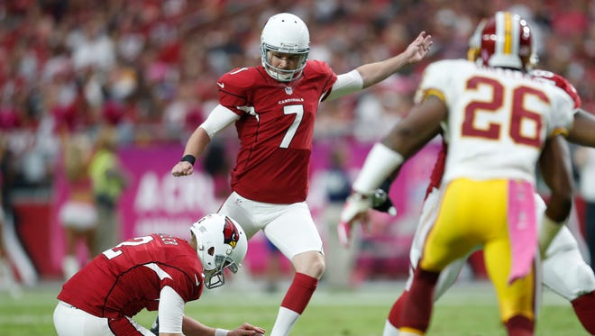 Chandler Catanzaro kicks a field goal against the Redskins during the fourth quarter of NFL action at University of Phoenix Stadium in Glendale, Ariz. October 12, 2014.