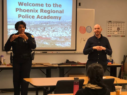 Phoenix Police Chief Jeri Williams speaks at an educational outreach even for residents who are deaf and hard of hearing on March 24, 2018, as Dustin McLaws, licensed sign-language interpreter, looks on. The event aimed to bridge communication barriers and establish a better sense of understanding between law enforcement and the deaf community.