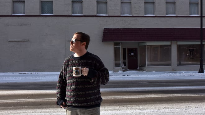 Jacob Byk enjoys the winter morning sunshine with a cup of coffee on Friday.