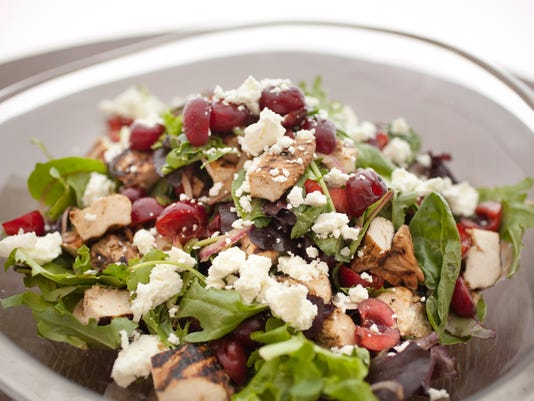 Chicken salad with cherries, orange and goat cheese