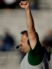 Baylor head coach Matt Rhule motions to his players during the first half of an NCAA college football game against Kansas, Saturday, Nov. 30, 2019, in Lawrence, Kan. (AP Photo/Charlie Riedel)