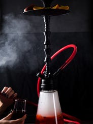 A hookah is a water pipe that is used to smoke flavored and sweetened tobacco.