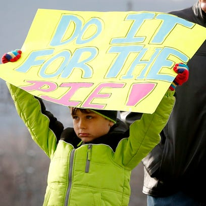 John McKane, 6, of Corning, cheers on his father and