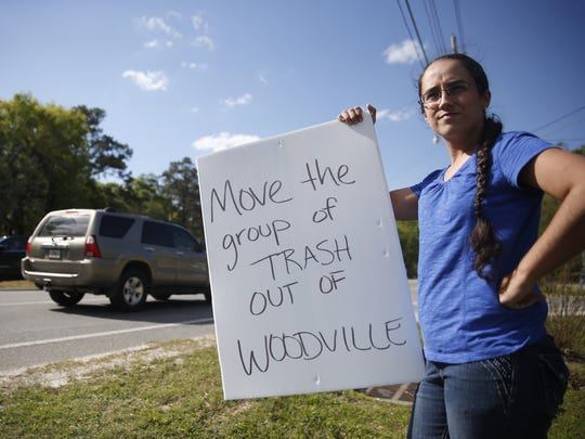 """Christina Wortham protests on the roadside of Woodville Highway out of concern for the almost a dozen sexual offenders who are being housed less than 1,500 feet from Woodville Elementary school, where her child is enrolled. """"There are sex offenders everywhere you go, but not usually under one roof,"""" said Wortham in this 2016 photo."""