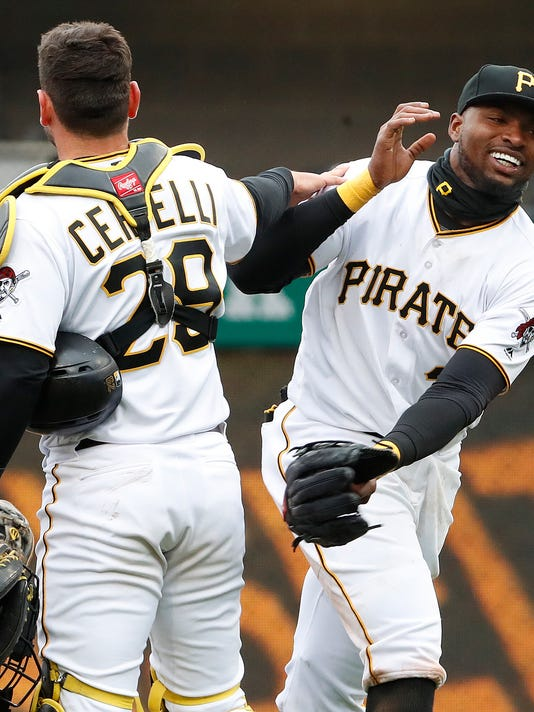 Pittsburgh Pirates' Gregory Polanco, right, celebrates with catcher Francisco Cervelli (29) after getting the final out of a 5-4 win over the Minnesota Twins in the Pirates' home opener baseball game in Pittsburgh, Monday, April 2, 2018. (AP Photo/Gene J. Puskar)