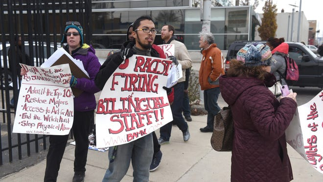 BAMN protestors hold signs as they vow to continue sickouts announced during a press conference outside the Detroit School of the Arts as seven Detroit Public Schools campuses were shut down due to a sickout on Thursday.