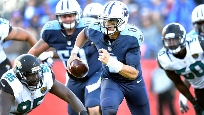 Titans quarterback Marcus Mariota (8) scrambles 87 yards for a touchdown past the Jaguars defense during the fourth quarter at Nissan Stadium Sunday Dec. 6, 2015, in Nashville, Tenn.