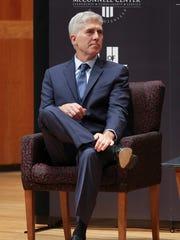 Supreme Court Associate Justice Neil Gorsuch listens