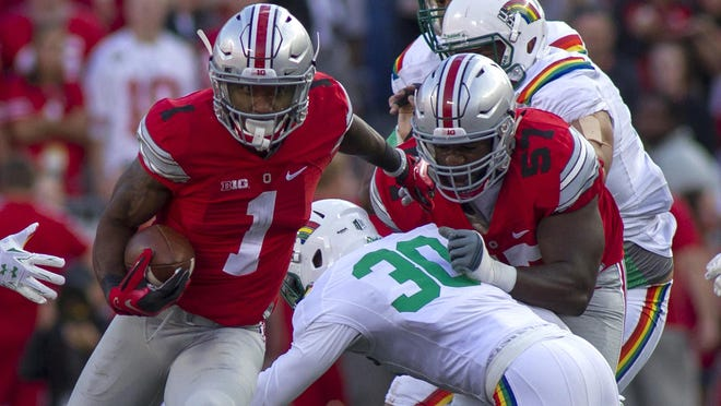 Sep 12, 2015; Columbus, OH, USA; Ohio State Buckeyes wide receiver Braxton Miller (1) runs the ball in the second half of the game against the Hawaii Warriors at Ohio Stadium. Ohio State beat Hawaii 38-0. Mandatory Credit: Trevor Ruszkowski-USA TODAY Sports