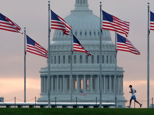 The IRS had encouraged tax filers to re-examine their withholding amount out of their paychecks in 2018 in light of the new federal tax rules. But many did not do it. IRS is waiving some penalties that might have applied. FILE - In this Sept. 27, 2017, file photo, a early morning runner in front of U.S. Capitol.